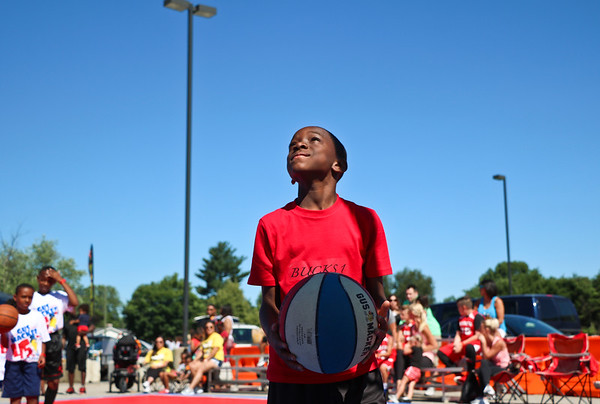 LEANDRA BEABOUT | THE GOSHEN NEWS<br /> Anthony Furlow, 10, gazes up at the hoop before shooting a the ball at Saturday's Gus Macker tournament in Elkhart.