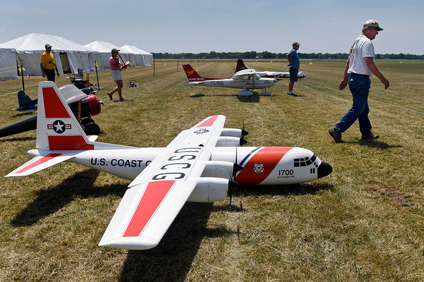 BEN MIKESELL | THE GOSHEN NEWS<br /> Pilots walk past their remote-control planes during a press event Wednesday to promote the Air Supremacy RC show which will run from July 12-14 at the Goshen Municipal Airport.