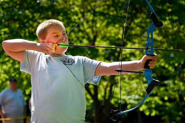 BEN MIKESELL | THE GOSHEN NEWS<br /> Eleven-year-old Webelos Kaden Balentine, Osceola, draws his bow at the archery range Thursday morning during the Cub Scout Day Camp at Ox Bow Park. 176 scouts spent the week learning about different survival skills including cooking, archery and first aid across 16 different stations around the park.