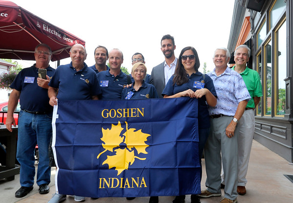 GEOFF LESAR | THE GOSHEN NEWS<br /> <br /> Argentinian members of the Rotary Friendship Exchange gather with Goshen Mayor Jeremy Stutsman and Elkhart Rotary Club member Doug Risser Friday afternoon outside The Electric Brew in Goshen. The visiting Rotarians are from two Argentinian provinces and will spend two weeks in the United States sharing cultural perspectives and broadening international understanding, among other activities. From left are Pedro E. Wolcheff, Carlos Caridi, Gustavo Flores, Oscar Bruno, Carlos Torres (back), Alicia Álvarez Iturregui, Stutsman, Agustina Fabiano, Risser and Goshen Rotarian Steve Pettit.