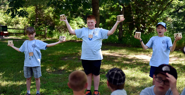 BEN MIKESELL | THE GOSHEN NEWS<br /> Webelos test their endurance by holding up die and answering questions at a station during Cub Scout Day Camp Thursday at Ox Bow Park.