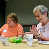"BEN MIKESELL | THE GOSHEN NEWS<br /> Erma Yoder, right, of Goshen laughs with Peg Malott of Goshen while making pendants out of Sculpey clay during the Open Art Studio for Families Tuesday afternoon at Goshen Hospital. The Living with Cancer Support Group has organized sessions every second and fourth Tuesday from April to June in the Center for Cancer Care at the hospital. Yoder, who has been cancer-free for 10 years, has been coming to the support group for six, and she said the group has been a great way to stay connected with friends. ""That's what I like about the Cancer Center,"" Yoder said. ""These people are my buddies."" Tuesday's crafting event took the place of the Healing Rhythm drum circle activity, which has been rescheduled to July 24."