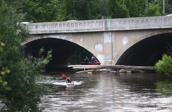 STEPHEN BROOKS | THE GOSHEN NEWS<br /> Water rescue teams respond to a call about a body in the Elkhart River Thursday night.