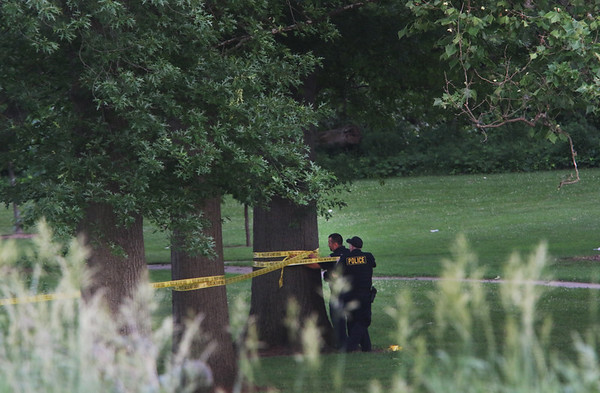 AIMEE AMBROSE | THE GOSHEN NEWS<br /> Goshen police tape off an area near the bank of the Elkhart River in Rogers Park. Police responded to a call about a body in the river Thursday evening.