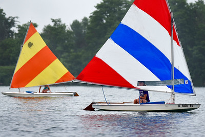 BEN MIKESELL | THE GOSHEN NEWS Sail boats soar across the water during Sail Camp Wednesday morning at Fidler Pond in Goshen.