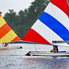 BEN MIKESELL | THE GOSHEN NEWS<br /> Sail boats soar across the water during Sail Camp Wednesday morning at Fidler Pond in Goshen.
