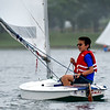 BEN MIKESELL | THE GOSHEN NEWS<br /> David Stutzman, 11, Goshen, adjusts his sail during Sail Camp Wednesay morning at Fidler Pond in Goshen.