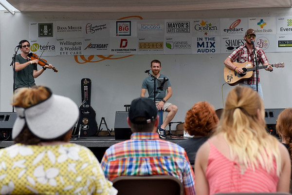 BEN MIKESELL | THE GOSHEN NEWS<br /> Mishawaka-based band, Lakebed, plays for the crowd gathered at the beginning of the 5th Annual Arts on the Millrace Saturday in Goshen.