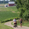 Roger Schneider | The Goshen News<br /> Ryan and Sally Boring, Elkhart, job along the Pumpkinve Nature Trail with their son Royce, 8-months-old, on June 16, 2018. The couple were running up the hill north of C.R. 127.