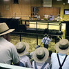 LIZ RIETH | THE GOSHEN NEWS<br /> Amish watch a cow up for auction Tuesday at the Topeka Livestock Auction. Cattle and livestock are purchased in weekly auctions.