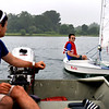 BEN MIKESELL | THE GOSHEN NEWS<br /> David Stutzman, 11, Goshen, gets help from instructor Bryan Bahler of Wawasee during Sail Camp Wednesay morning at Fidler Pond in Goshen.