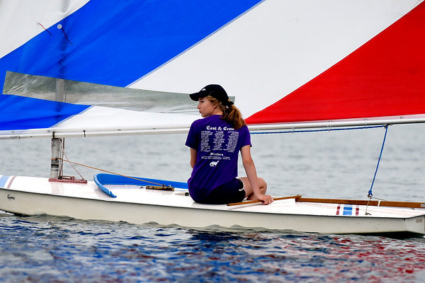 BEN MIKESELL | THE GOSHEN NEWS<br /> Mara Schrock, 13, Goshen, makes her way across the water during Sail Camp Wednesday morning at Fidler Pond in Goshen.