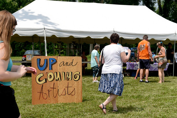 BEN MIKESELL | THE GOSHEN NEWS The Up & Coming Artists tent at the Arts on the Millrace event features four local youth artists, whose application fees were waived thanks to a Little Big Idea Grant.