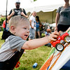BEN MIKESELL | THE GOSHEN NEWS<br /> Jack Burgess of Holly, Michigan, 2, uses a toy truck to paint on a mural in the Young at Art tent during the Arts on the Millrace event Saturday in Goshen.
