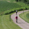 Roger Schneider | The Goshen News<br /> Dawn Buchanan of Freemont, Indiana, rides up a hill on the Pumpkinvine Nature Trail Saturday during the annual Pumpkinvine Bike Ride. Ride official Tim Drescher said more than 1,000 people registered for the ride and 852 had actually ridden in the event by noon. The ride raises funds to close the gap in the trail between Goshen and Middlebury and will also provide funds for maintenance.