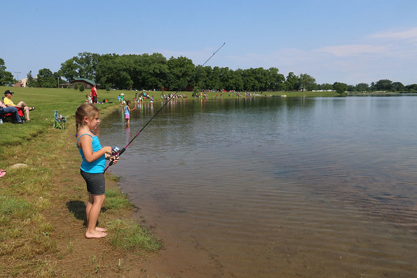Roger Schneider| The Goshen News<br /> Grace Keene, 7, of Goshen, waits for a fish to bite during Saturday's fishing tournament at Goshen's Fidler Pond Park.