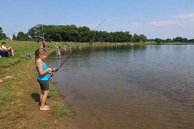 Roger Schneider| The Goshen News Grace Keene, 7, of Goshen, waits for a fish to bite during Saturday's fishing tournament at Goshen's Fidler Pond Park.