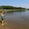 Roger Schneider| The Goshen News<br /> Grace Keene, 7, of Goshen, waits for a fish to bite during Saturday's fishing tournament at Goshen's Fidler Pond Park.