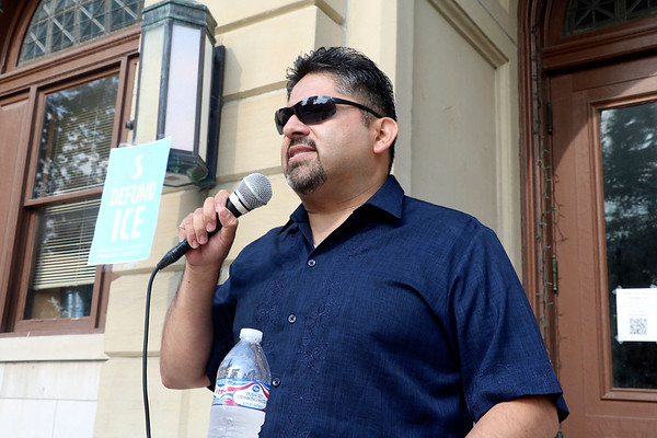 AIMEE AMBROSE | THE GOSHEN NEWS<br /> <br /> Felipe Merino, A Goshen attorney who specializes in immigration cases, was among the speakers at a rally at the Elkhart County Courthouse lawn Saturday to protest federal immigration policies that lead to the separation of children from adults in illegal border-crossing cases.