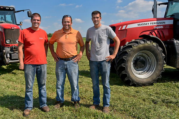 BEN MIKESELL | THE GOSHEN NEWS<br /> The owners of Hoosier Custom Ag, from left, Brad Paulus, founder Gerald Miller and Ben Paulus, operate their custom bailing out of Miller's fourth-generation family farm on C.R. 15.
