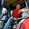 BEN MIKESELL | THE GOSHEN NEWS<br /> Brad Paulus, Goshen, climbs into a tractor used for cutting and bailing hay Thursday at the Hoosier Custom Ag farm on C.R. 15 in Goshen. Brad began helping Hoosier Custom Ag founder Gerald Miller in 2008-09.