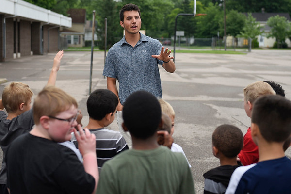 BEN MIKESELL | THE GOSHEN NEWS<br /> Heartland RV employee Alec Mark answers questions during RV tours Wednesday morning with children from the Elkhart Boys & Girls Club. Thor Motor Coach and Heartland RV provided three vehicles for children to observe during the event, which is one of four planned throughout the summer at the Boys & Girls Club.