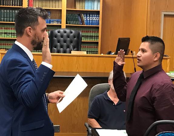 JOHN KLINE | THE GOSHEN NEWS<br /> Goshen Mayor Jeremy Stutsman, left, swears in Antonio Medina as a new reserve officer with the Goshen Police Department during Monday's Board of Public Works and Safety meeting.