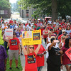 AIMEE AMBROSE | THE GOSHEN NEWS<br /> <br /> About 600 people rallied at the Elkhart County Courhouse lawn Saturday, protesting federal immigration policies that lead to the separation of children from adults in illegal border-crossing cases.