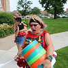 AIMEE AMBROSE | THE GOSHEN NEWS<br /> <br /> Lori Kay, Goshen, bellows while pounding a bucket during a call to make some noise during a rally at the Elkhart County Courthouse lawn Saturday. About 600 people protested federal immigration policies that lead to the separation of children from adults in illegal border-crossing cases.