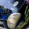 SHEILA SELMAN | THE GOSHEN NEWS<br /> A baseball written on by Chief Wade Branson's daughter rests against his police vehicle Saturday afternoon.