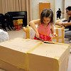 LIZ RIETH | THE GOSHEN NEWS Emi Kaufman, 7, helps unpack the gamelan at Goshen College.