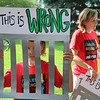 Margaret Coppens-Clark, Mishawaka, and her family were among about 600 people at a rally at the Elkhart County Courhouse lawn Saturday, protesting federal immigration policies that lead to the separation of children from adults in illegal border-crossing cases.