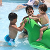 SHEILA SELMAN | THE GOSHEN NEWS<br /> Juan Cedeno, Goshen, helps his nephew, Antony Cedeno ride the frog in the kiddie pool at Shanklin Pool Sunday afternoon.