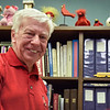 BEN MIKESELL | THE GOSHEN NEWS<br /> Bob Woods, a 1966 Ball State University graduate, stands in his BSU decorated office June 21 at Elkhart Memorial High School, where he is the director of business operations.