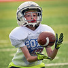 BEN MIKESELL | THE GOSHEN NEWS<br /> Lincoln Tuttle, 10, Goshen, catches a pass while participating in a receiver drill during the Goshen Junior Football League camp Tuesday at Goshen High School.
