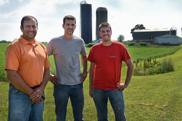 BEN MIKESELL   THE GOSHEN NEWS<br /> The owners of Hoosier Custom Ag, from left, founder Gerald Miller, and brothers Ben and Brad Paulus, operate their custom bailing out of Miller's fourth-generation family farm on C.R. 15.