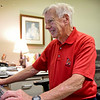 BEN MIKESELL | THE GOSHEN NEWS<br /> Bob Woods, a 1966 Ball State University graduate, works in his BSU decorated office June 21 at Elkhart Memorial High School, where he is the director of business operations.