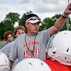 BEN MIKESELL | THE GOSHEN NEWS<br /> Goshen High School football head coach Kyle Park instructs Goshen Junior Football League campers to their stations Tuesday at Foreman Field in Goshen. GHS varsity coaches and players attended the week-long camp as well to teach children drills and proper techniques.