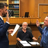 JOHN KLINE | THE GOSHEN NEWS<br /> Goshen Mayor Jeremy Stutsman, left, swears in Keith Miller, right, following his promotion from the rank of patrol captain to the rank of division chief of investigations with the Goshen Police Department during Monday's Board of Public Works and Safety meeting.