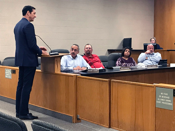 JOHN KLINE | THE GOSHEN NEWS<br /> Scott Sivan, an architect and managing partner with Mishawaka-based Insite Development, left, speaks to members of the Goshen Board of Zoning Appeals Tuesday about his firm's plan to construct a new upscale apartment building near the Goshen millrace.