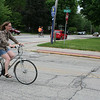 "SHEILA SELMAN | THE GOSHEN NEWS<br /> Dru Mack of Goshen rides along Purl Street having come from Goshen Public Library, while a couple rides tandem along Fifth Street Tuesday afternoon. To encourage more people to ride, Mayor Jeremy Stutsman will be hosting his third annual Mayor's Ride Thursday, starting at 5:15 p.m. Those who want to participate can join the mayor in the parking lot east of City Hall, 202 S. Fifth St. The ride will end at The Chief. The ride is free and open to everyone. No advance registration is required. If there is a threat of rain, a cancellation will be posted on the city's Facebook page by 4:30 p.m. The Mayor's Ride coincides with Bicycle to Work Week and the Maple City Bicycle Advisory Committee is encouraging Goshen residents to bike to work this week. ""For trips of less than two miles, it's often faster to go by bicycle than by car in the city,"" Stutsman said. ""We hope people will 'test the water' of bicycle commuting ... and enjoy the exercise and not having to pay the high price of gas."""