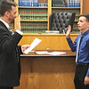 JOHN KLINE | THE GOSHEN NEWS<br /> Goshen Mayor Jeremy Stutsman, left, swears in Goshen High School student Felix Perez-Diener as the Goshen City Council's new youth adviser for the 2018-19 school year during Tuesday's council meeting.