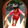 SHEILA SELMAN | THE GOSHEN NEWS<br /> Adrian Avila, 6, New Paris, climbs up the slide at Sunnyside Park in New Paris Monday afternoon.