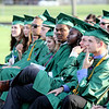 SHEILA SELMAN | THE GOSHEN NEWS<br /> Concord graduates listen as art teacher Bob Bieber speaks during commencement Thursday night at Jake Field.