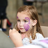 """LEANDRA BEABOUT   THE GOSHEN NEWS<br /> Landrie Kuhns, 5, Goshen, gets her face painted inside the Goshen powehouse at the June 9 """"Summer Night at the Powehouse"""" market."""
