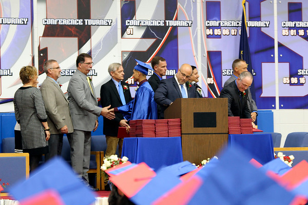 SHEILA SELMAN | THE GOSHEN NEWS<br /> West Noble graduates receive their diplomas and shake hands with school board members during commencment Sunday afternoon at West Noble High School.
