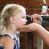 "LEANDRA BEABOUT | THE GOSHEN NEWS Haven Christiana, 4, Lakeville, smiles as she gets her face painted during the ""Summer Night at the Powehouse"" market."