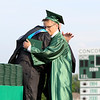 SHEILA SELMAN   THE GOSHEN NEWS<br /> Joshua Riker, right, hugs Concord High School Principal Greg Dettinger as he accepts an honorary diploma for his twin sister, Mary, who died during the school year.