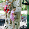 SHEILA SELMAN | THE GOSHEN NEWS<br /> Caroline Looney, 10, Goshen, left, and Hazel Looney, 8, Goshen, climb the wall at Sunnyside Park in New Paris Monday afternoon.