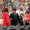 Geoff Lesar   The Goshen News<br /> NorthWood High School graduate Juan Pantoja, of Nappanee, bumps fists with a fellow graduate during the school's commencement ceremony Friday evening in Nappanee.